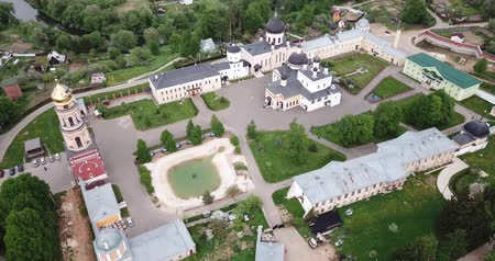 davide : Picturesque aerial view of Ascension David hermitage - Orthodox male monastery in small Russian village of Novy Byt Filmati Stock