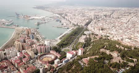 Коста : Aerial view of cityscape and harbour of Spanish city of Malaga in spring day Стоковые видеозаписи