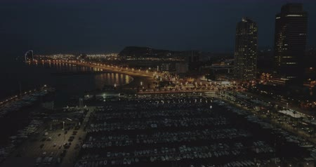 night scape : Landscape of illuminated Barceloneta Beach in summer night in Barcelona, Spain Stock Footage