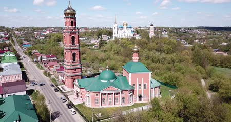 megmentő : Scenic architectural ensemble of ancient Savior Transfiguration Cathedral and Trinity Church with extended bell tower on Bolkhov cityscape background, Russia Stock mozgókép