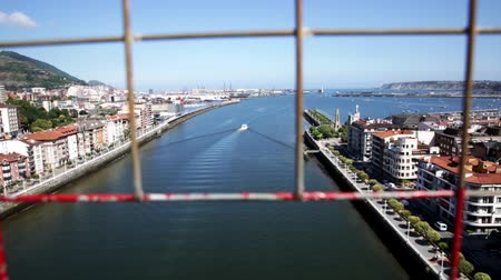 vizcaya : View from Vizcaya Bridge of Getxo cityscape on bank of Nervion river overlooking Church of Our Lady of Mercy, Basque Country, Spain