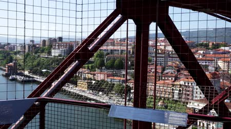 обрамление : View of  summer cityscape of Portugalete through metal structures of Vizcaya Bridge, Spain Стоковые видеозаписи