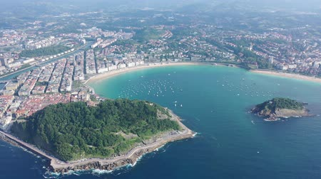 basque : Scenic view from drone of Spanish town of San Sebastian (Donostia) on southern coast of Bay of Biscay on sunny summer day, Basque Country