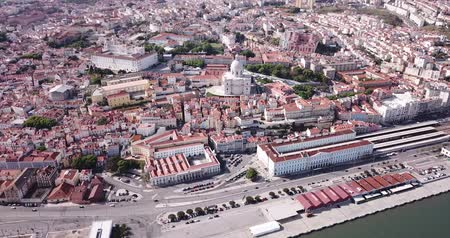 alfama : Picturesque aerial view of historical district of Lisbon on bank of Tagus river with medieval Monastery and white baroque building of Church of Santa Engracia, Portugal Stock Footage
