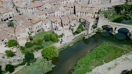 romanico : View from drone of medieval Spain town of Besalu with Romanesque bridge over Fluvia river