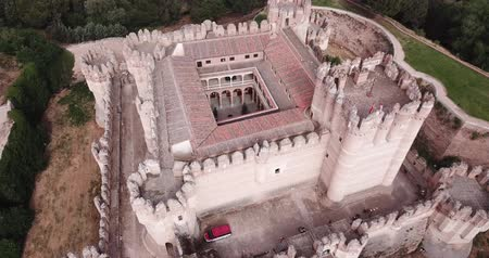 fortresses : Aerial view of impressive Spanish Mudejar architecture of Castle in Coca municipality, central Spain