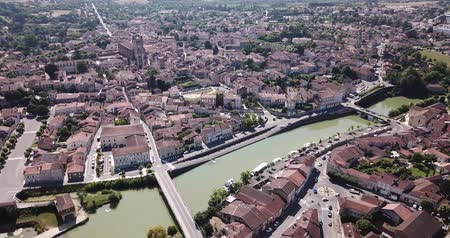 impressive skyline : Aerial view of Condom cityscape on banks of Baise river overlooking Catholic cathedral, France