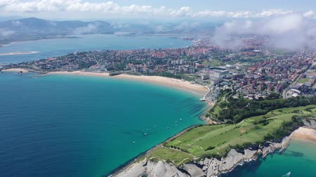 kék háttér : Scenic view from drone of coastal Spanish town of Santander on sunny summer day, Cantabria Stock mozgókép