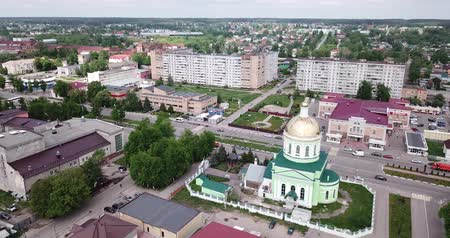 templomtorony : Ozyory, Russia - May 13, 2019:  Aerial panoramic view of cityscape of Ozyory overlooking Orthodox Holy Trinity Cathedral, Russia
