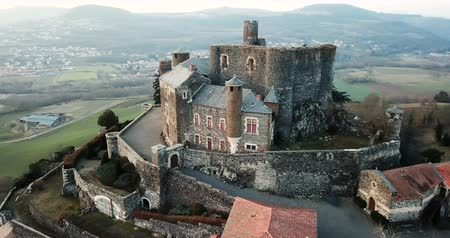 fortificado : Aerial view of ancient fortified castle of Chateau de Bouzols in cloudy winter day, Arsac-en-Velay, France Stock Footage