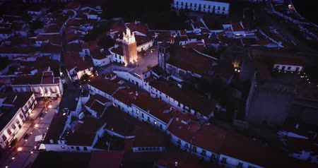 citadela : Aerial view of Sepra cityscape with medieval Castle and square Clock Tower at night, Portugal