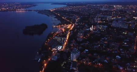 voronezh : Scenic view from drone of illuminated Russian city of Voronezh overlooking Voronezh River at night