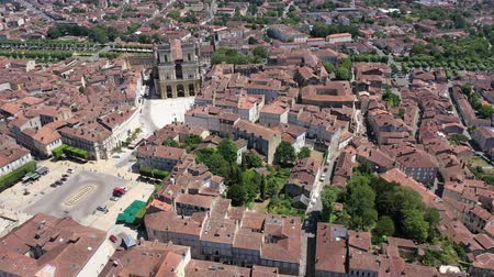 d day : Aerial view of colorful Auch cityscape on Gers river with Sainte-Marie Cathedral and Tour d Armagnac on sunny summer day, France Stock Footage