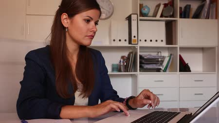 competence : Successful adult business woman using laptop at workplace