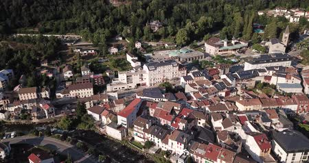 forestal : Aerial view of small French town of Ax-les-Thermes on banks of mountain river of Ariege on summer day