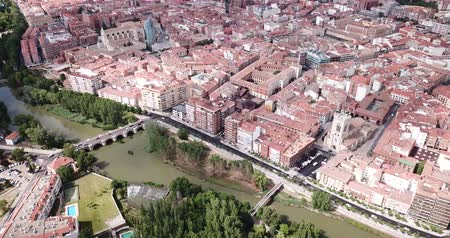 carrion : Aerial view of Palencia cityscape on Carrion river with Catholic Cathedral in summer day, Spain Stock Footage