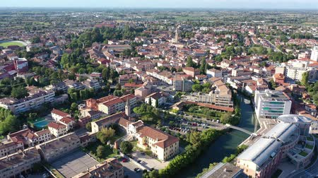 sights : Scenic cityscape from drone of Italian town of Portogruaro in sunny day, Veneto, Italy
