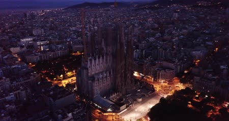 haziran : Barcelona, Spain - June 12, 2019: Temple Sagrada Familia at night from a drone. Barcelona