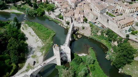 vöröses : View from drone of medieval Spain town of Besalu with Romanesque bridge over Fluvia river