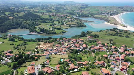 látnivalók : Scenic view from drone of coastal Spanish township of Comillas on sunny summer day, Cantabria