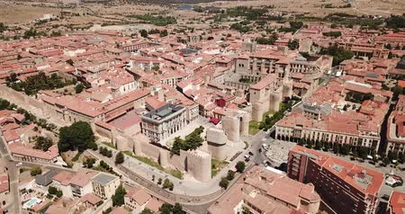 fortificado : Aerial view of cityscape of fortified city of Avila with its town walls and ancient Cathedral of Saviour, Spain Stock Footage