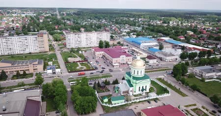 エディフィス : Ozyory, Russia - May 13, 2019:  Aerial panoramic view of modern cityscape of Ozyory overlooking Orthodox Holy Trinity Church, Russia