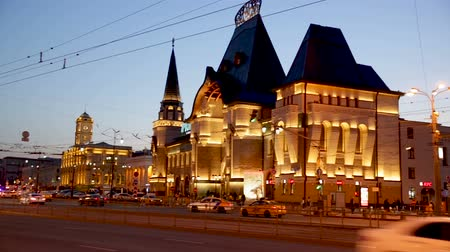 demiryolu : MOSCOW, RUSSIA - APRIL, 30, 2019:  Night view of Yaroslavsky railway station building illuminated at dusk, Moscow, Russia