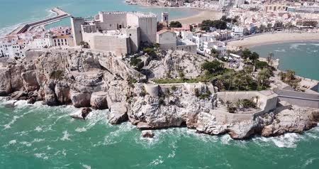 monumentális : Picturesque aerial view of medieval Peniscola Castle on rocky hilltop on Mediterranean coast, Spain Stock mozgókép
