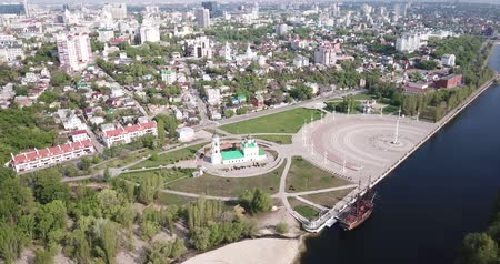 riverbank : Aerial view of Admiralty square of Voronezh with Assumption Church and Ship Museum on background with modern cityscape, Russia Stock Footage