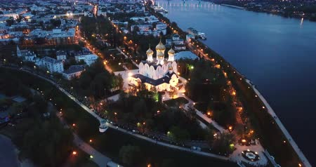 architectural heritage : Scenic view from drone of medieval Yaroslavl Orthodox Assumption cathedral on background with Volga River and cityscape at night, Russia