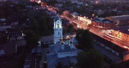 アンサンブル : Scenic view from drone of Cathedral of Intercession of Holy Virgin with belfry and M7 Volga Highway with Pokrov twilight cityscape on background