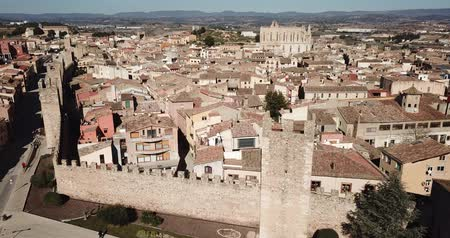 katalán : Panoramic aerial view of small town of Montblanc with medieval fortification wall in sunny day, Spain Stock mozgókép