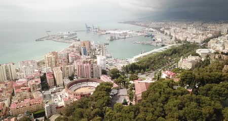 Андалусия : Aerial view of cityscape and harbour of Spanish city of Malaga in spring day Стоковые видеозаписи