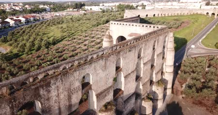 tiered : View of Amoreira Aqueduct with four registers of  waterway at extreme height near Portuguese town of Elvas