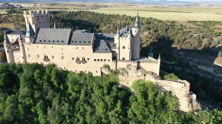király : Aerial view of fortress Alcazar of Segovia. Spain Stock mozgókép