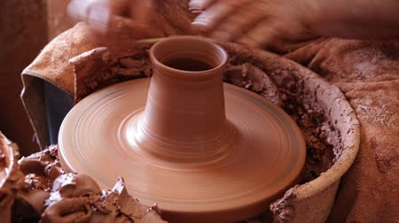 terrakotta : Close up of hands working on pottery wheel in workshop Stock mozgókép