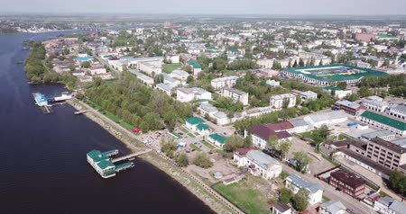 エディフィス : Scenic view from drone of Kostroma cityscape on bank of Volga River with complex of provincial trading arcades (Gostiny Dvor), Russia 動画素材