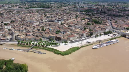 impressive skyline : Aerial view of Libourne cityscape on banks of Dordogne river overlooking Gothic spire of Church of St. John Baptist, France Stock Footage