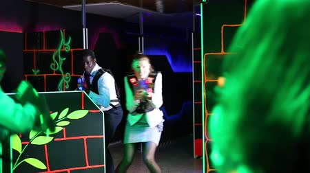 esportivo : Emotional portrait of men and women co-workers having corporate entertainment in laser tag room