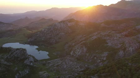 lagos : Panoramic view from the drone on the mountain lake. Lagos de Cavadonga. Picos de Europa. Spain Stock Footage