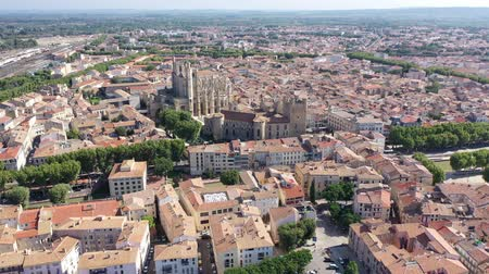 suyolu : Picturesque aerial view of Narbonne cityscape overlooking ancient Gothic building of Cathedral of Saints Justus and Pastor, France Stok Video