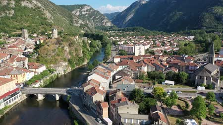ariege : General aerial view of small French town of Tarascon-sur-Ariege in valley of Pyrenees on banks of Ariege river on summer day Stock Footage