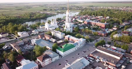 resurrection : Shuya, Russia - May 10, 2019:  Aerial view of Shuya Orthodox Resurrection cathedral and bell tower on background with Teza River and cityscape, Russia