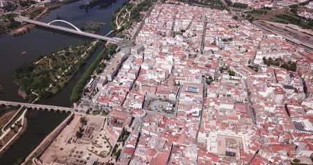 emerita : Aerial view of modern Merida cityscape overlooking antique Roman amphitheatre and Theatre and monumental Plaza de Toros, Spain Stock Footage