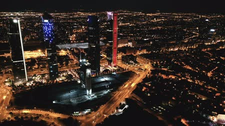 haziran : Night view of the four towers (Cuatro Torres) of the business district in Madrid. Spain Stok Video