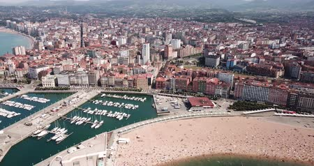 mooring : Aerial view of cityscape and marina of Spanish city of Gijon in sunny summer day