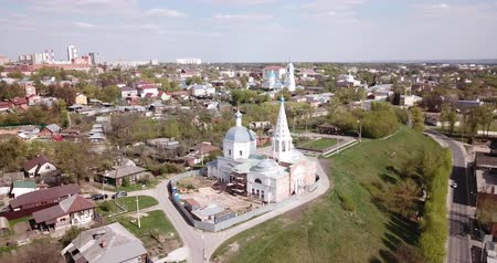 bell tower : Scenic cityscape of Russian town of Serpukhov overlooking church steeples in sunny spring day