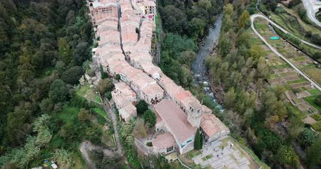 hegytömb : Aerial view of Castellfollit de la Roca, medieval Catalan hamlet on cliff on autumn day