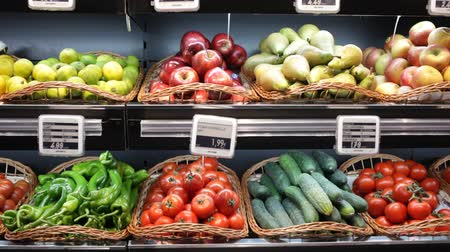 összeg : Colorful market counter with large assortment of fresh fruits and vegetables for sale