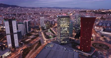 barcellona : Picturesque view from drone of night Barcelona. Illuminated major business district with modern skyscrapers
